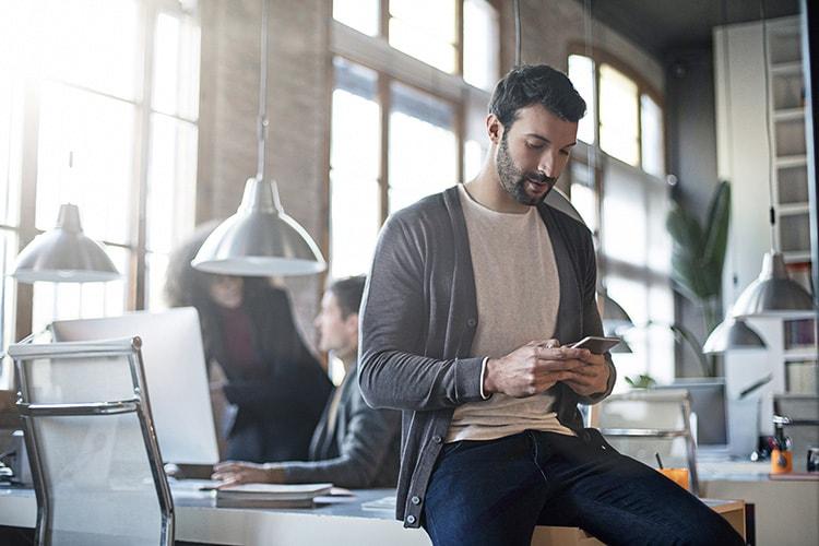 Digital Agency Growth Strategist Monitoring Mobile ROI