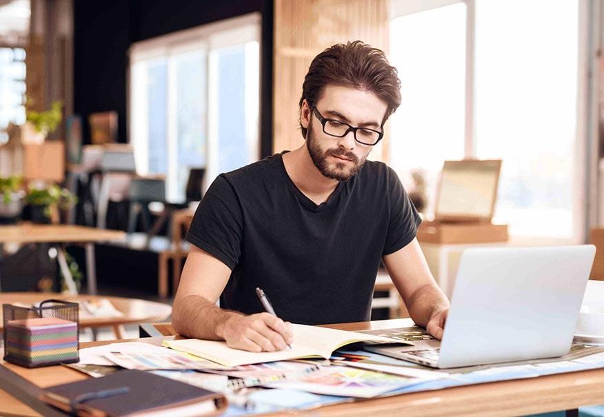 Digital-Marketing-services Team-Leader-Working-At-Desk